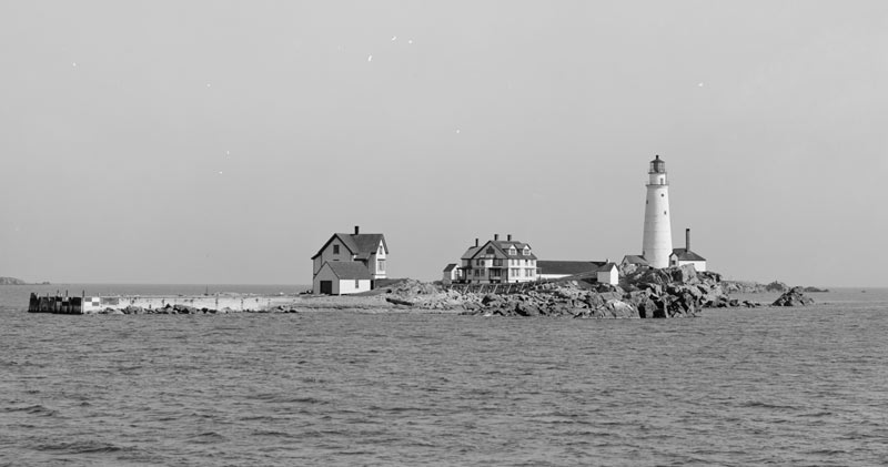 The lighthouse was located on Little Brewster Island in Boston Harbor and was first lit September 14, 1716.