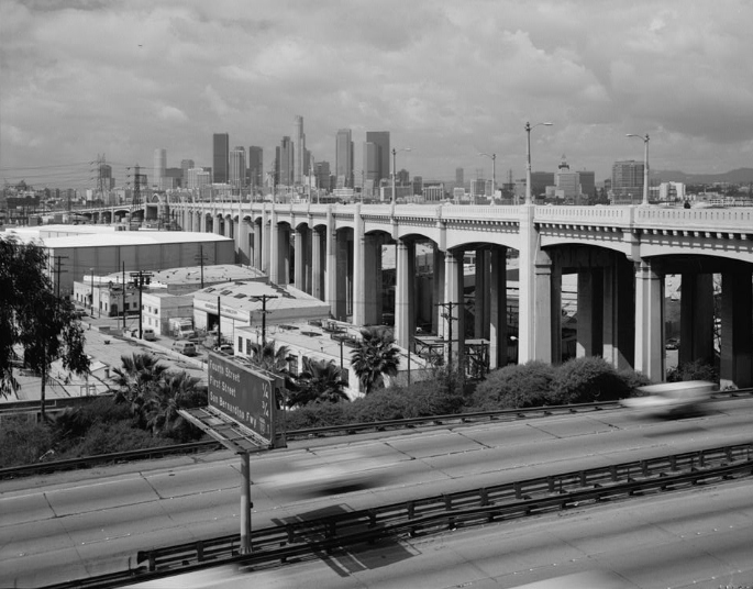 It spans the Los Angeles River, the Santa Ana Freeway (US 101), and the Golden State Freeway (I-5), as well as Metrolink and Union Pacific railroad tracks and several local streets.