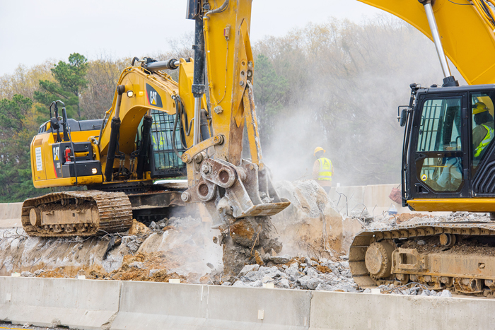 A construction crew demolishes concrete on south-bound I-30 near the I-430 interchange.