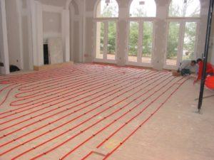 PEX tubing used in a hydronic (warm-water) radiant heating system.